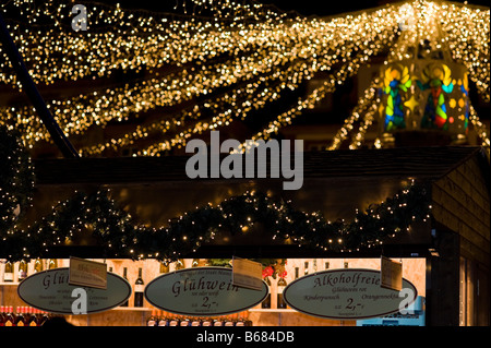 Light chains shining above a 'Glühwein' stall on a christmas market. - Stock Photo