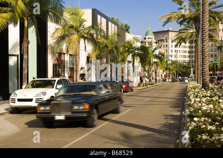 View of Rodeo Drive and Passing Limousine, Beverly Hills, California, USA - Stock Photo