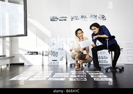 Man and woman working, architects - Stock Photo