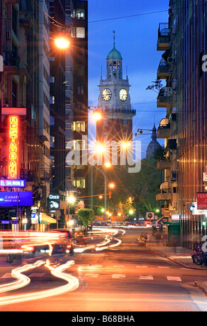 'Monumental Tower' seen from Downtown street at dusk. Downtown, Buenos Aires, Argentina. - Stock Photo