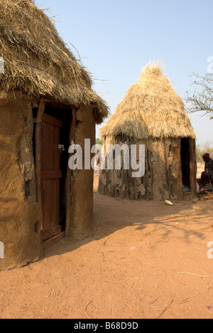 Traditional village huts built from mud and dung at the Himba Oase Village near Kamanjab Namibia Africa - Stock Photo