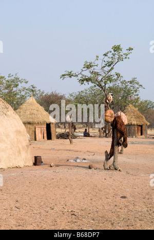 Traditional village huts built from mud and dung at the Himba Oase Village, near Kamanjab, Namibia - Stock Photo