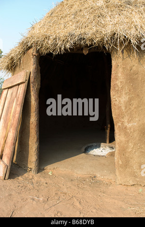 Inside a traditional village hut built from mud and dung at the Himba Oase Village, near Kamanjab, Namibia, Africa - Stock Photo