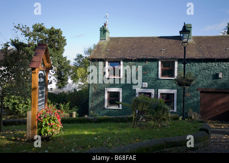 Yew Tree cottage and entrance to St Peters church in Heysham Village Lancashire - Stock Photo