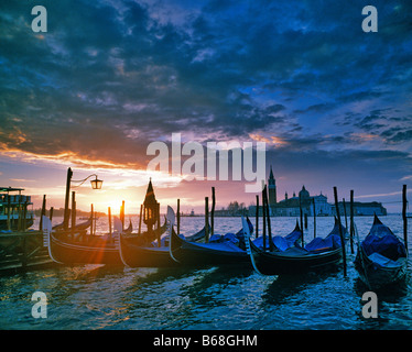 Sunrise along the San Marco Canal Venice Italy Seen from Piazza San Marco Gondolas on Canal bank 67 H I C Adriatic - Stock Photo