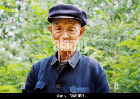 Portrait of a senior man wearing a flat cap, Zhigou, Shandong Province, China - Stock Photo