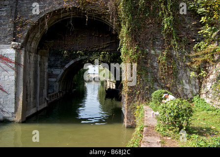 Angler fishing at Panmen land and Water Gate entrance to ancient walled city over protective moat - Stock Photo