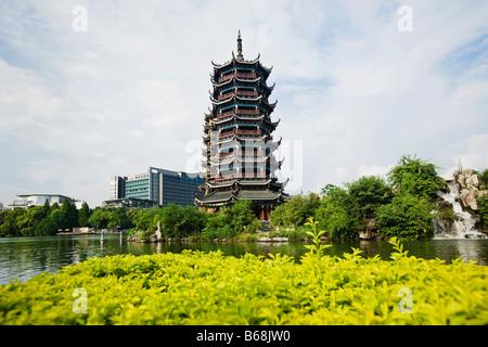 Pagoda at lakeside, Banyan Lake, Guilin, Guangxi Province, China - Stock Photo