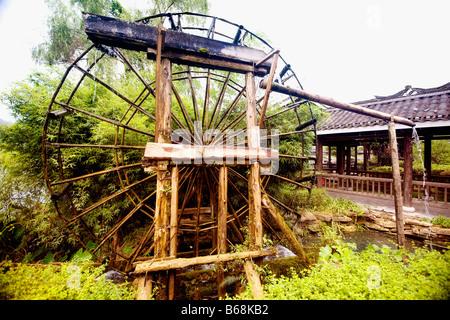 Watermill in a field, Yangshuo, Guangxi Province, China - Stock Photo