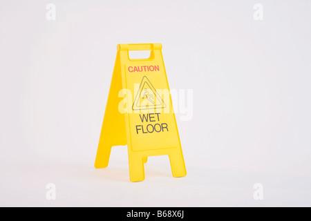 Wet floor warning sign - Stock Photo