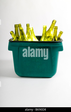 Green wine bottles in kerbside recycling crate - Stock Photo
