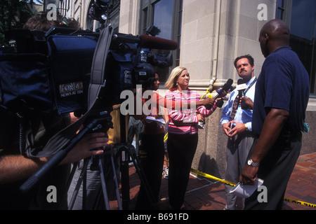 Police Chief giving television interviews Lancaster City Pennsylvania USA - Stock Photo