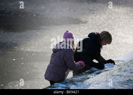 Children playing in winter - Stock Photo