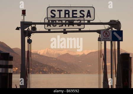the pier of Stresa at dusk Lake Maggiore Piedmont Italy - Stock Photo