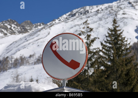 telephone box sign on the Italian Alps - Stock Photo