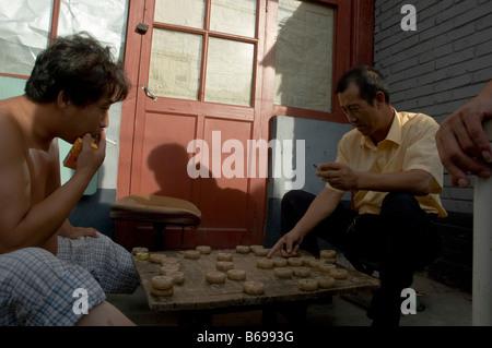 two men play chinese chess (xiangqi) - Stock Photo