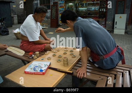 Two men playing chinese chess (xiangqi) - Stock Photo