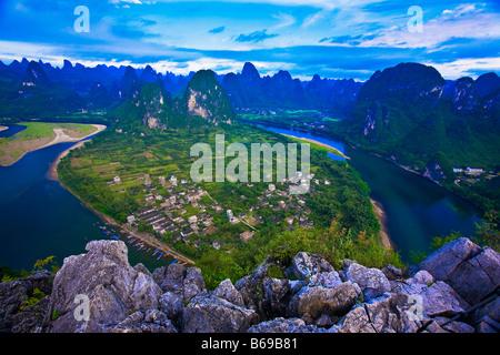 High angle view of a river passing through mountains, Li River, XingPing, Yangshuo, Guangxi Province, China - Stock Photo