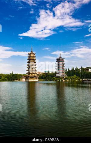 Pagodas at lakeside, Sun And Moon Pagoda, Banyan Lake, Guilin, Guangxi Province, China - Stock Photo
