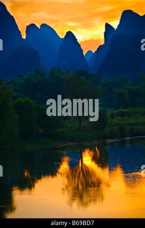 Silhouette of hills at dawn, Guilin Hills, Li River, Yangshuo, Guangxi Province, China - Stock Photo