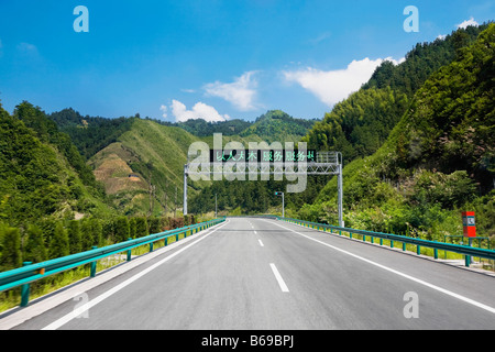 Road passing through mountains, Huangshan Mountains, Anhui Province, China - Stock Photo
