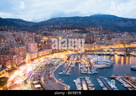 Overview Monaco, Monte Carlo, harbour with luxury boats and ships at dusk, France, Europe, EU - Stock Photo