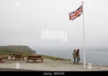 A flagpole flying The Union Jack at Land's End in Cornwall at the south-westerly tip of England - Stock Photo