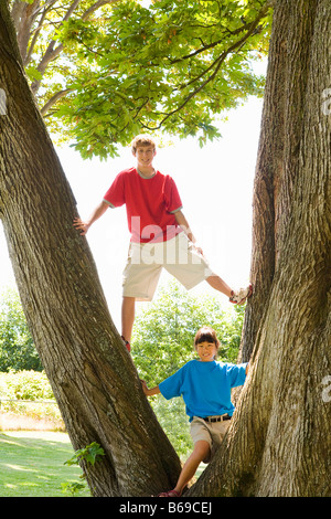 Two friends playing in a park - Stock Photo