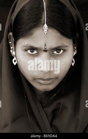Indian woman staring face portrait. Andhra Pradesh, India. Sepia tone - Stock Photo