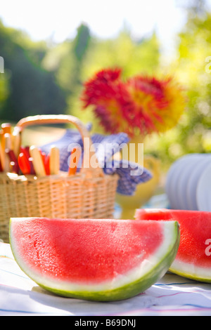 Two watermelon slices with a basket on a table - Stock Photo