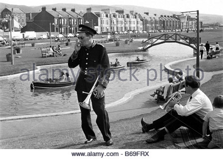 The English at play in the 1970s Part 2 Bandsmen at seaside reort - Stock Photo