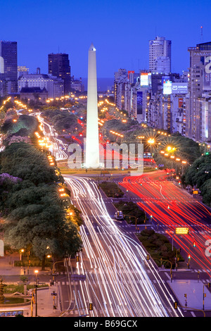 Aerial view of 9 de Julio Avenue, with Obelisco Monument, at night, with car lights traces. Buenos Aires, Argentina - Stock Photo
