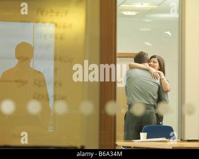 Office couple cuddling - Stock Photo