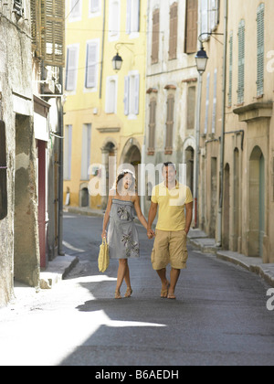 Couple walking down street in provence - Stock Photo