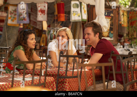 Friends talking in french market cafe - Stock Photo
