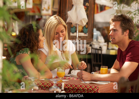 Friends in french market cafe - Stock Photo