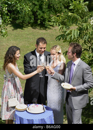 Wedding party toasting the couple - Stock Photo