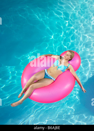 Young Girl Sleeping Floating On An Inflatable Raft Stock
