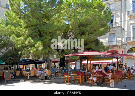 restaurant tables under a tree shade in karya main square stock photo royalty free image. Black Bedroom Furniture Sets. Home Design Ideas
