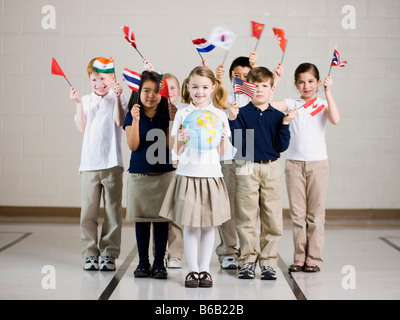 school children waving flags of different countries - Stock Photo