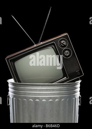 tv in the trash - Stock Photo