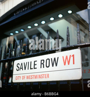 Savile Row W1 City of Westminster street sign hanging on a black railing, London, England, UK KATHY DEWITT - Stock Photo