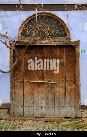 very old village door - Stock Photo