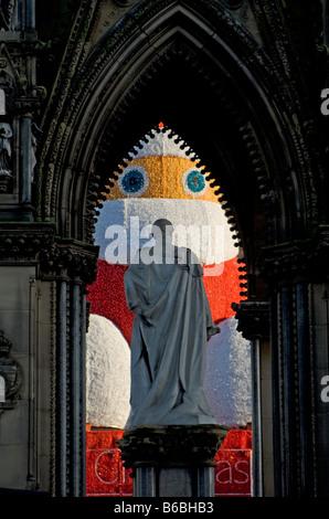 Santa display seen through Prince Albert memorial, Albert Square, Manchester, UK. - Stock Photo