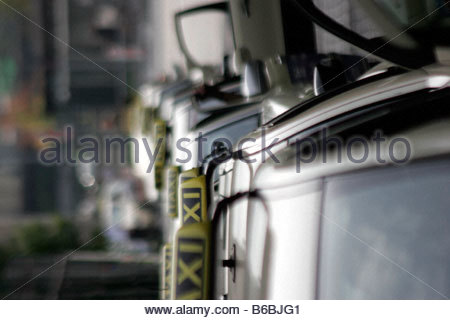 Taxi parked in row - Stock Photo