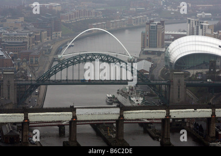 Aerial view of the Tyne Bridge and Gateshead Millennium Bridge crossing The Tyne River, Newcastle upon Tyne, England - Stock Photo