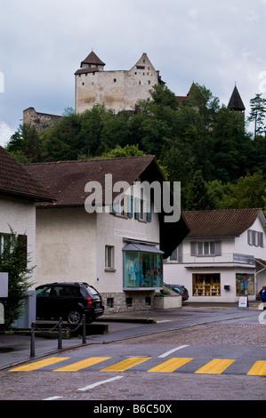 A castle  on a hill over small town Balzers in Liechtenstein - Stock Photo