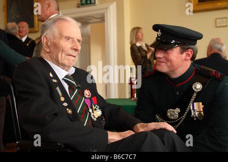 Harry Patch British 1st World War 1 trench fighting survivor talking with Lieutenant Rupert Lane MC at Wells Town - Stock Photo