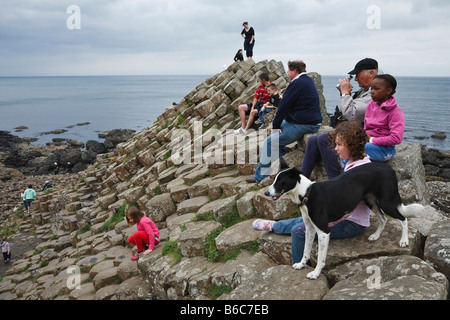 Tourists at the Giant's Causeway, County Antrim, Northern Ireland - Stock Photo