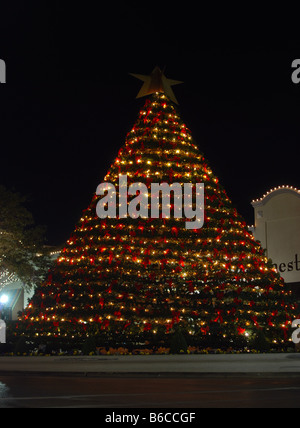 Large Christmas Tree in an Outdoor Mall - Stock Photo